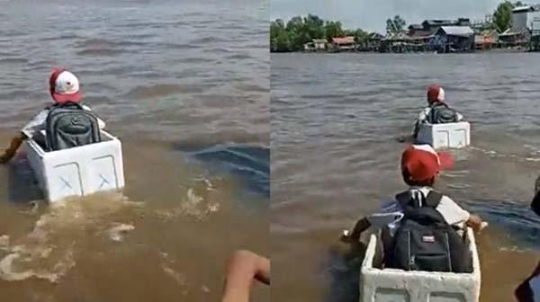 Fadli Zon Syok Lihat Video Siswa Menyeberang Sungai Pakai Styrofoam. (Twitter/@UmarChelsea_70/suara.com)