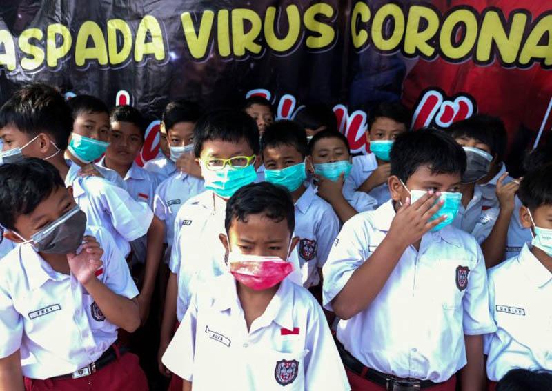 FOTO : Ilustrasi Anak Sekolah Dasar Menggunakan di Saat Wabah Corona/Sumber ; Google
