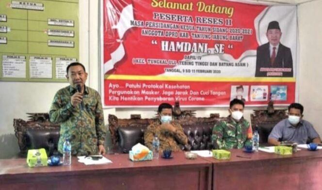 FOTO : Hamdani, SE saat reses di Desa Kampung Baru kecamatan Batang Asam, Kamis (11/02/21)