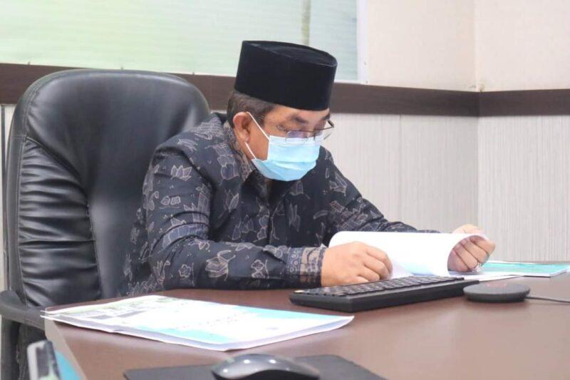 Bupati Tanjab Barat H. Anwar Sadat Saat Paparan Rencana Aksi Pengembangan SDM pada Pembekalan Kepemimpinan Pemerintahan Dalam Negeri secara Tatap Maya, Kamis (29/07/21). FOTO : PROKOPIM